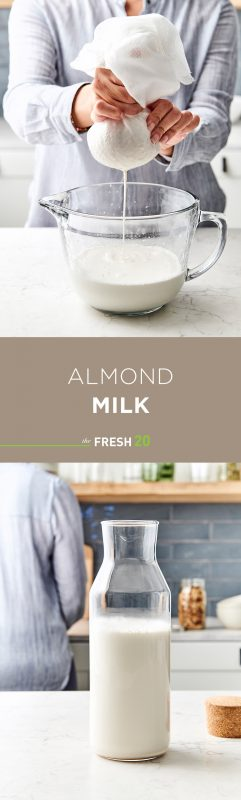 Woman squeezing almond milk through cheese cloth into glass bowl & a beautiful tall glass milk jug full of creamy easy DIY almond milk