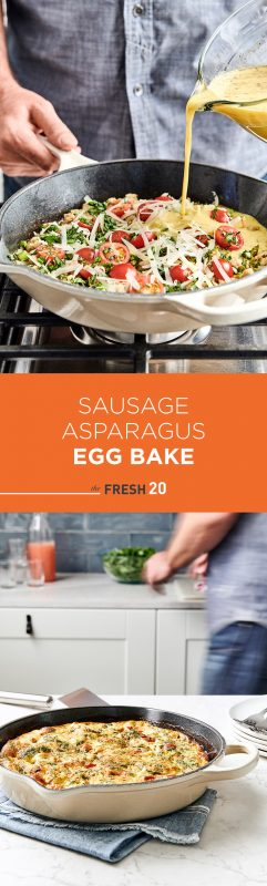 Man pours egg mixture into a pan full of vegetabes & a large metal skillet full of sausage asparagus egg bake on top of a blue napkin