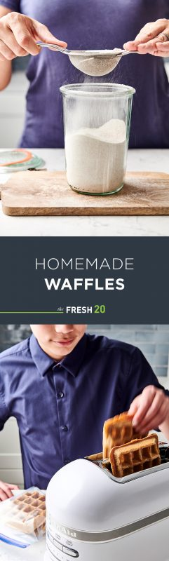Woman sifting easy waffle mix into a glass containter & a young boy adding DIY homemade waffles into a white KitchenAid toaster