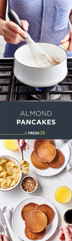 Woman whisking pancake batter in white pot on cooktop & 2 stacks of fluffy pancakes with apple compote on white marble surface