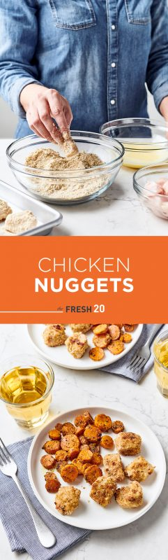 Woman breading chicken nuggets in a glass bowl of bread crumbs, parmesean & egg wash with honey roasted carrots on a white marble surface