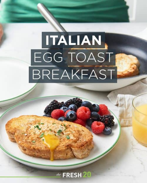 Woman serving easy Italian egg toasts with mixed berries in a white marble kitchen