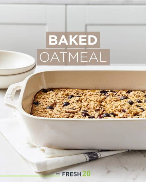 Staub baking pan filled with homemade baked oatmeal on a white marble surface and linen napkin