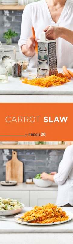 Woman shredding carrots with a box grater & carrot slaw with raisins on a ceramic plate in a white marble kitchen