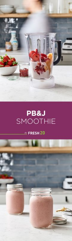 Blender full of peanut butter, strawberries, jam with 2 mason jars of PB&J smoothies in a white marble kitchen