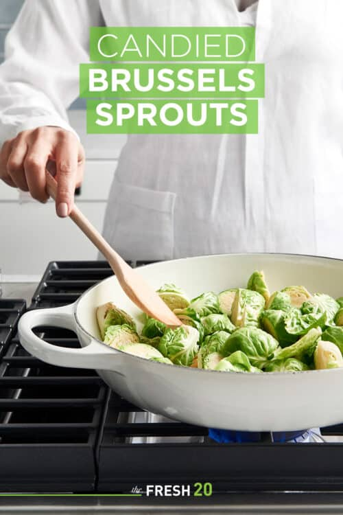 Woman cooking candied brussels sprouts on a stove in a white skillet