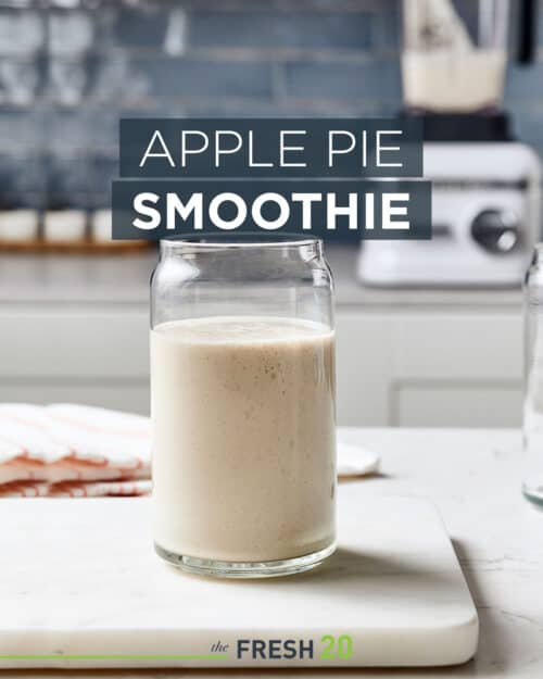 Glass of easy healthy apple pie sugar-free smoothie treat on a white marble surface in a beautiful modern kitchen