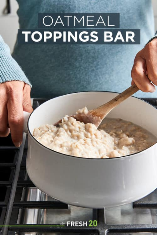 Woman stirring a fresh batch of oatmeal in a white pot on a black metal cooktop