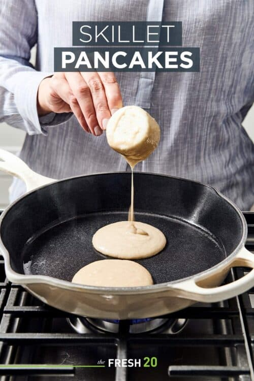 Woman pouring creamy paleo pancake batter into skillet on a gas cooktop