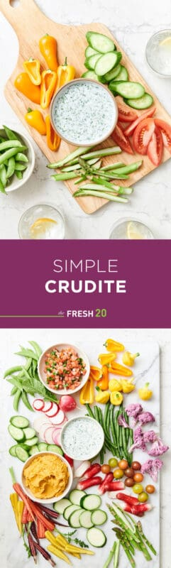 Simple crudites platters elegantly filled with a variety of cut vegetables & bowls of dips on a white marble surface